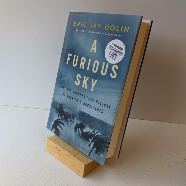 Signed hardcover copy of A Furious Sky by Eric Jay Dolin