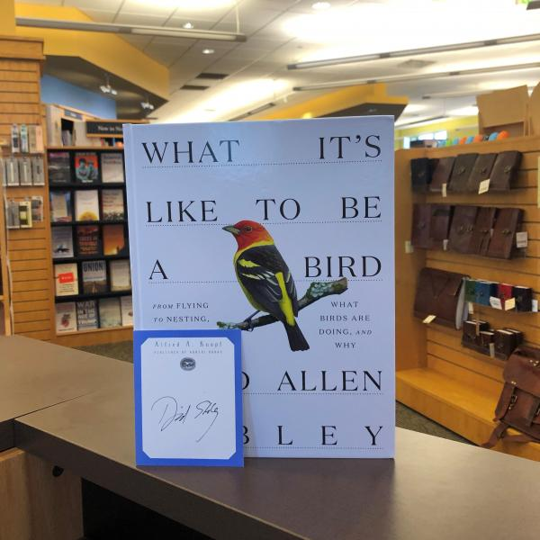 A hardcover copy of What It's Like to Be A bird by David Allen Sibley is posed with a signed bookplate. The bookplate is a publisher bookplate, bordered with blue and the Alfred A Knopf header