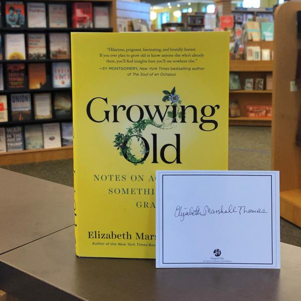 A hardcover copy of Growing Old by Elizabeth Marshall Thomas is posed with a signed bookplate