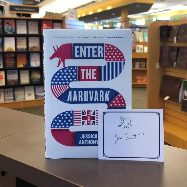 A hardcover copy of Enter the Aardvark by Jessica Anthony is posed with a signed bookplate