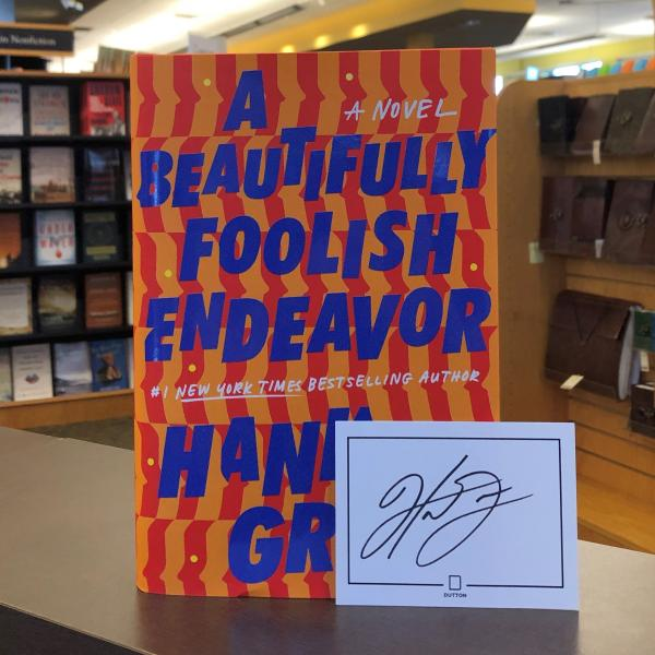 A hardcover copy of A Beautifully Foolish Endeavor by Hank Green is posed with a signed bookplate