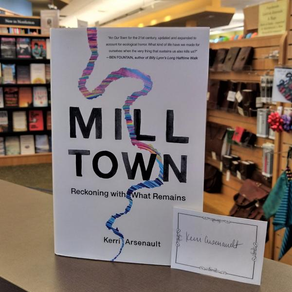 A hardcover copy of Mill Town by Kerri Arsenault is posed with a signed bookplate