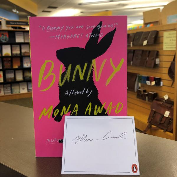 A paperback copy of BUNNY by Mona Awad is posed with a signed bookplate