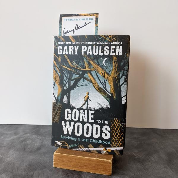 hardcover copy of Gone to the Woods, with themed bookplates signed by Gary Paulsen